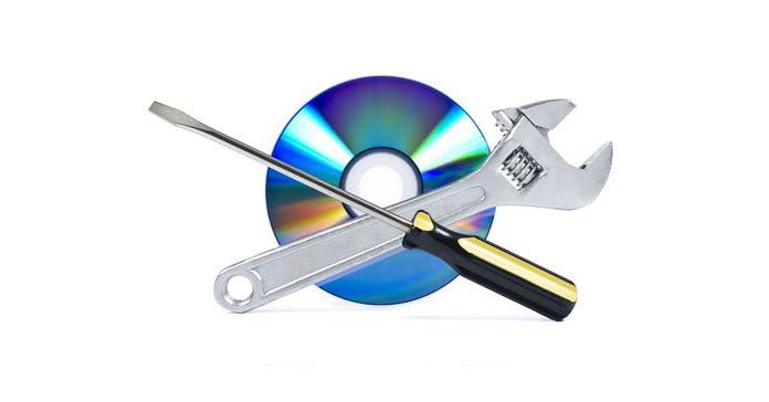 DVD disc with a spanner and screwdriver crossed in front alluding to DVD disc repair.