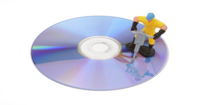 Worker repairing a DVD