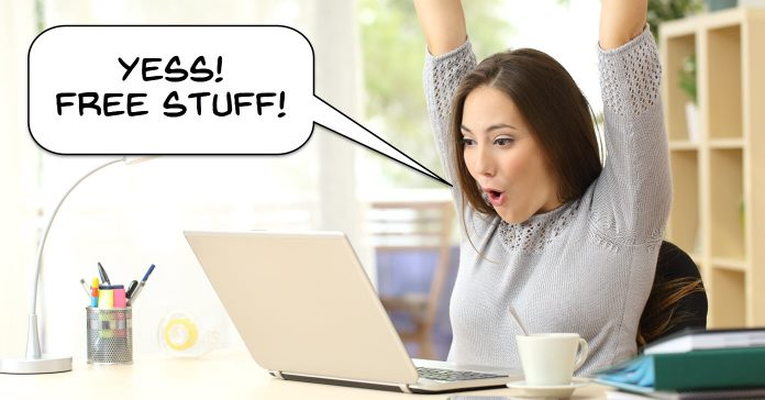 Woman at a computer excited to receive free stuff.
