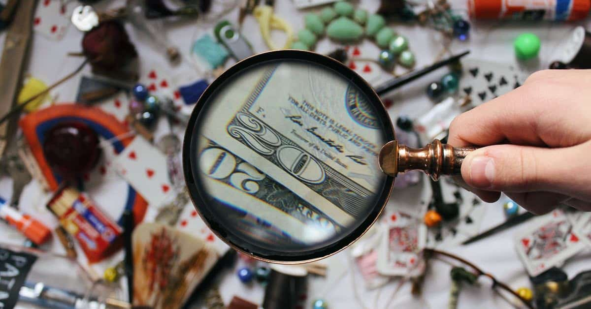 Image of magnifying glass over assorted objects on a table.