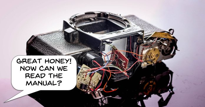 Image of a dismantled camera with a humorous caption questioning whether it is time to read the manual.